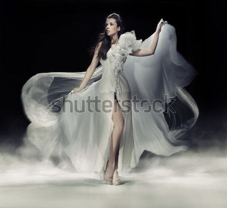 Art photo of a sexy woman in beautiful dress Stock photo © konradbak