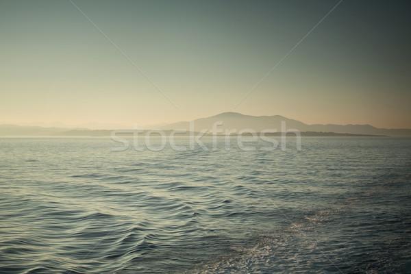 Sunset over the tropical sea Stock photo © konradbak