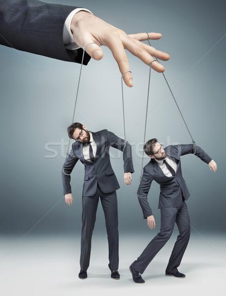 Conceptual photo of controlled employees Stock photo © konradbak