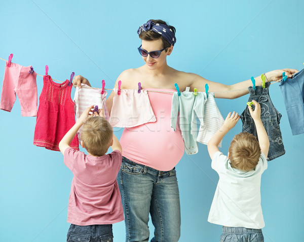 Mom doiing the laundry with her sons Stock photo © konradbak