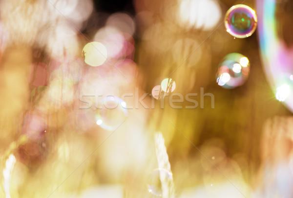 Zeepbellen groene hemel licht achtergrond Stockfoto © konradbak