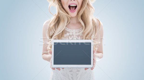 Stock photo: Pretty blond woman holding a tablet