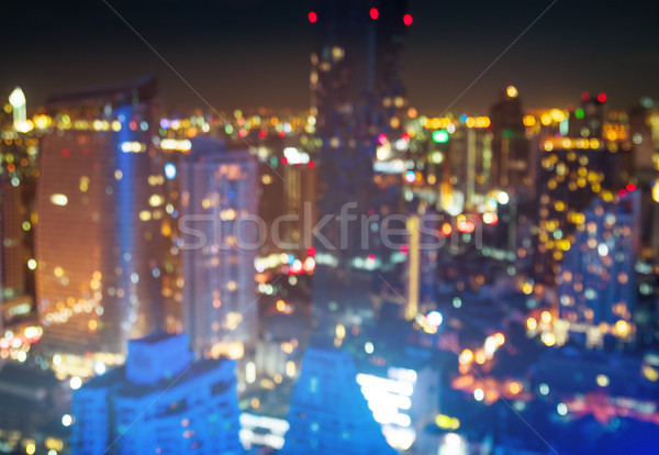 Cityscape vida noturna arranha-céus centro da cidade nuvens primavera Foto stock © konradbak