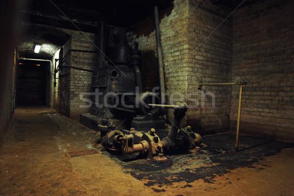 Old machinery in the dark building Stock photo © konradbak