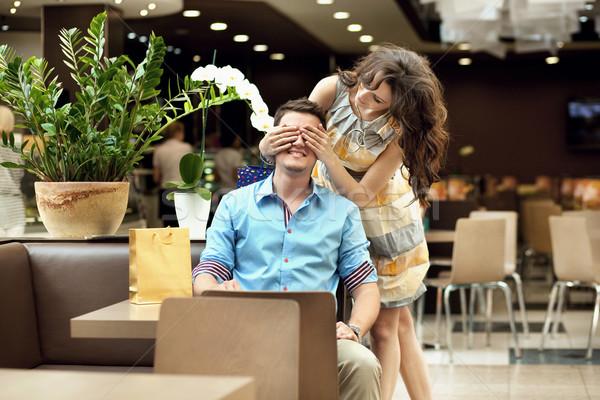 Smiling couple at the cafe Stock photo © konradbak