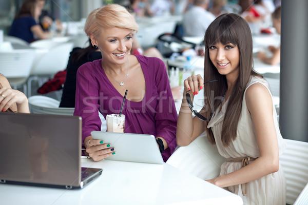 Two smiling women in a restaurant Stock photo © konradbak