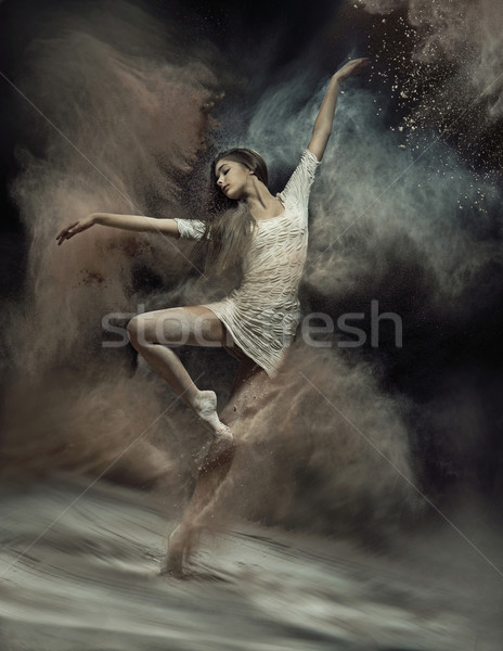 Dancing ballet dancer with dust in the background Stock photo © konradbak