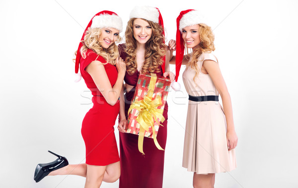 Sensual girls with santa's hats Stock photo © konradbak