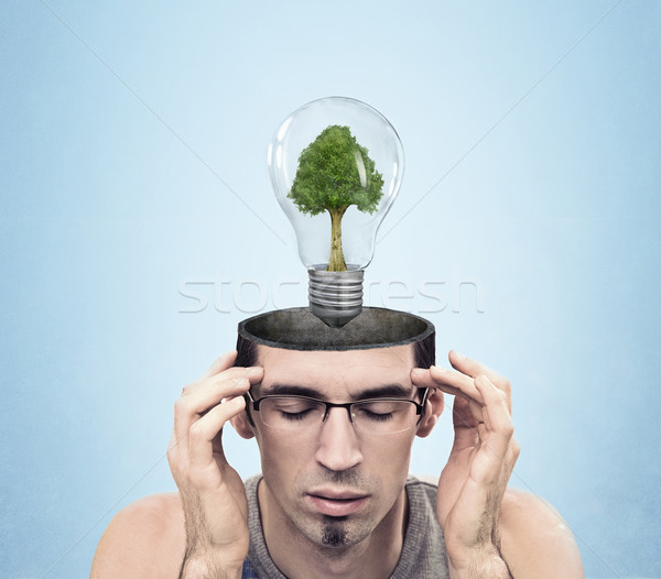 Open minded man with green energy symbol Stock photo © konradbak