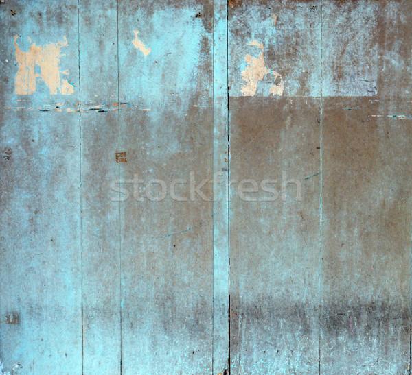 Grungy wooden building, old ragged planks Stock photo © konradbak