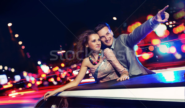 Elegant couple traveling a limousine at night Stock photo © konradbak