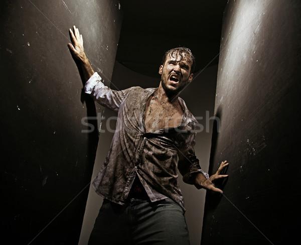 Yaralı adam hayatta kalma adam iş duvar Stok fotoğraf © konradbak