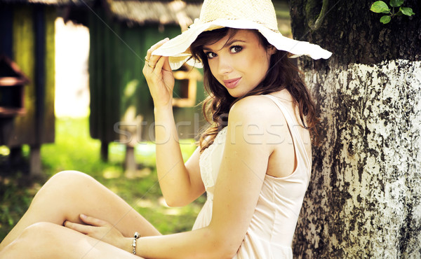 Mysterious smile of brunette young woman Stock photo © konradbak