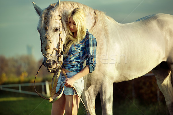 Stock photo: Portrait of a beauty blondie with horse