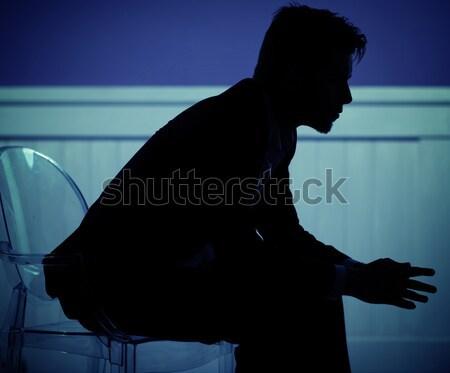 Sad man siting on the chair Stock photo © konradbak
