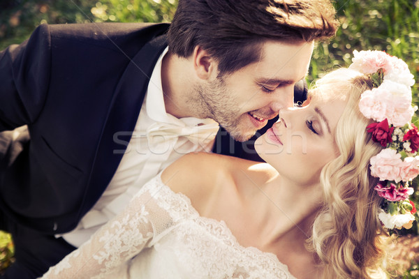 Romantic scene of kissing marriage Stock photo © konradbak