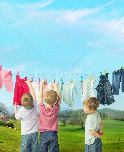 Cute little boys doing the laundry Stock photo © konradbak