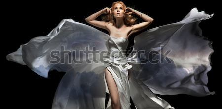 Butterfly lady Stock photo © konradbak