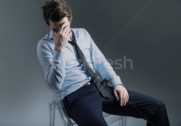 Stock photo: Miserbale banker lost all his money