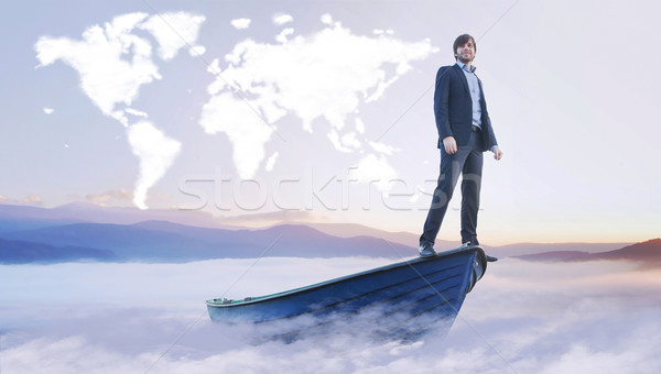 Young manager under the cloud world map Stock photo © konradbak