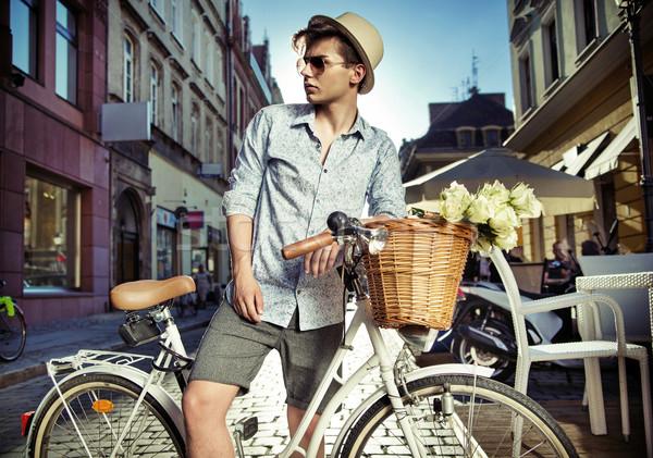 Elegant man on the retro bicycle Stock photo © konradbak