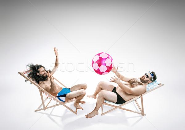 Dois engraçado caras sessão amigos feliz Foto stock © konradbak