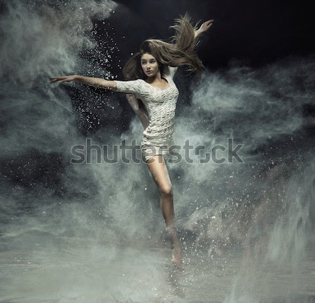 Dynamic photo of a stunning blonde beauty Stock photo © konradbak