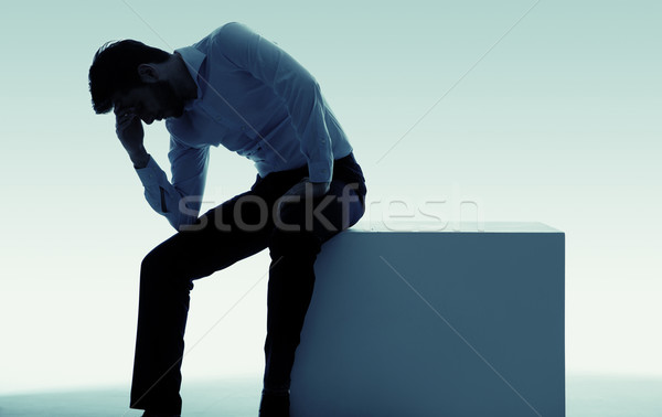 Exhausted miserable man with big problem Stock photo © konradbak