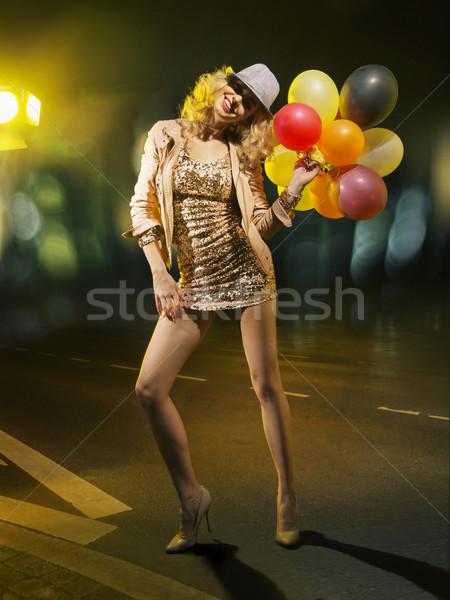 Blond alluring woman with balloons Stock photo © konradbak