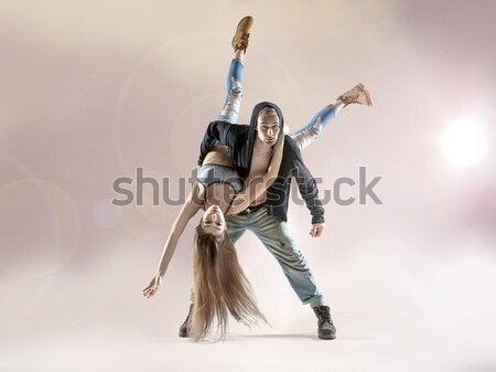 Strong hip-hop guy carrying his dance partner Stock photo © konradbak