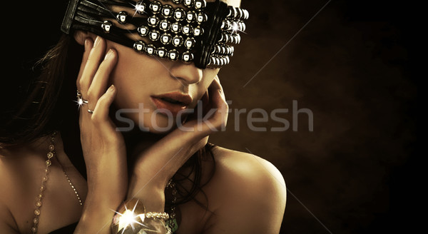 Portrait of a woman with covered eyes Stock photo © konradbak