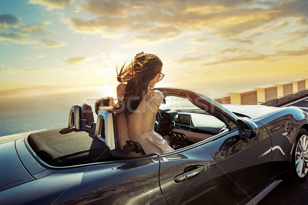 Relaxed couple riding a convertible Stock photo © konradbak