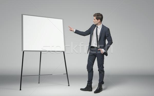 Young businessman making a lecture about business Stock photo © konradbak