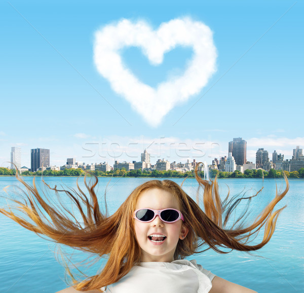 Stock photo: Ginger girl with a heartshaped cloud