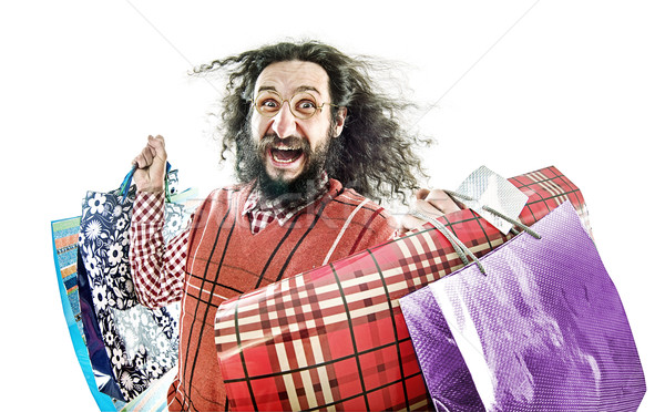 Funny nerd holding many shopping bags Stock photo © konradbak