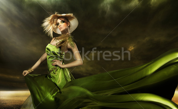 Stunning beauty over cloudy background Stock photo © konradbak