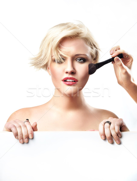 Portrait of a woman doing make up Stock photo © konradbak