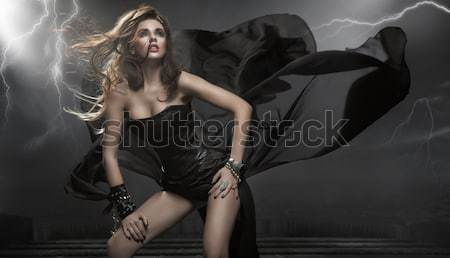 Attractive young fashion model posing in the studio Stock photo © konradbak