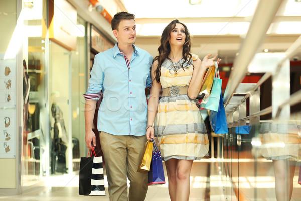 Pair of young people in a shopping center Stock photo © konradbak