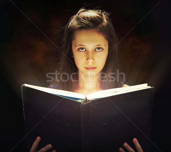 Ragazza apertura magia libro cute bambino Foto d'archivio © konradbak