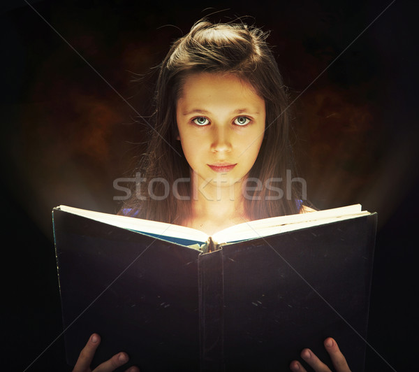 Girl opening the magic book Stock photo © konradbak