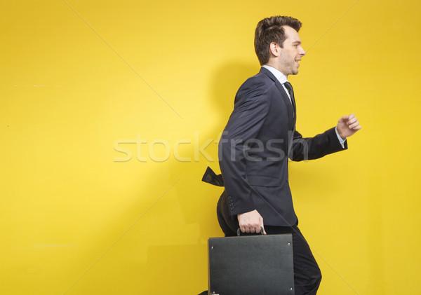 Succesful businessman with the suitcase Stock photo © konradbak