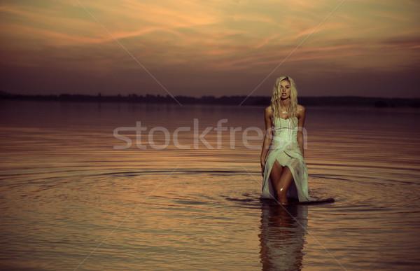 Water nymph walking in the lake Stock photo © konradbak