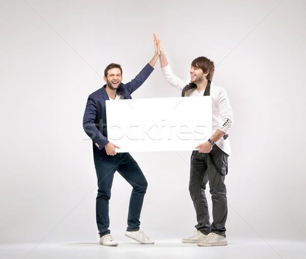 Two handsome friends giving each other a high-five Stock photo © konradbak