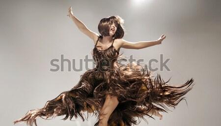 Young woman wearing dress made of hair Stock photo © konradbak