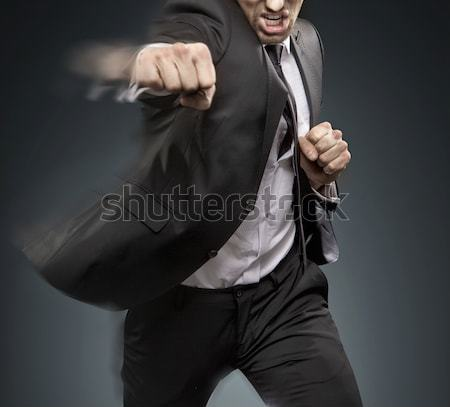 Muscular businessman tearing up his suit Stock photo © konradbak