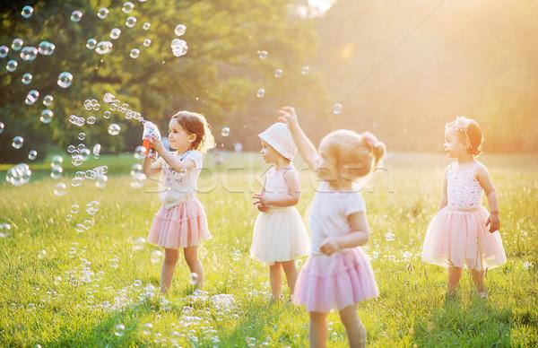 Groupe cute enfants bulles de savon enfants Photo stock © konradbak