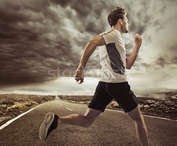 Young runner in an expressive pose Stock photo © konradbak