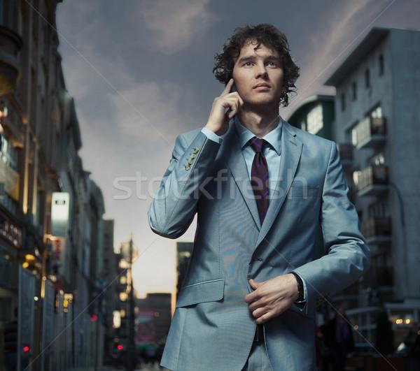 элегантный человека позируют городской улице лице счастливым Сток-фото © konradbak