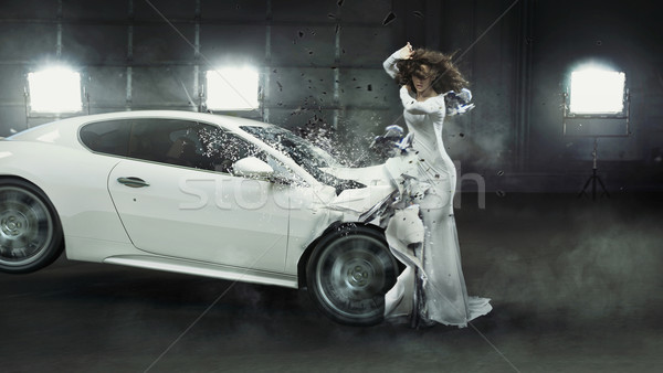 Alluring fashionable lady in the middle of car crash Stock photo © konradbak
